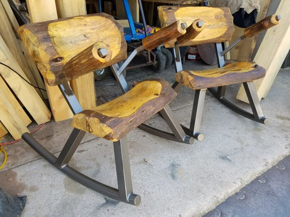 His and Hers Log Rocking Chairs with Arms
